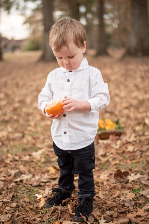 Toddler with orange