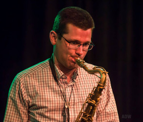 doug playing sax headshot.jpg