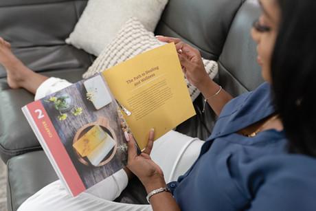 Woman reading wellness book