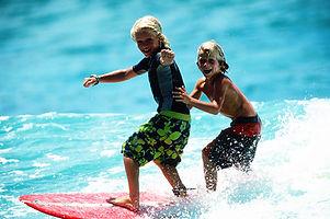 John John as a kid surfing in North Shore, Hawaii