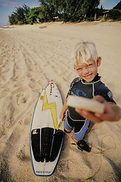 John John as kid with his board and wax
