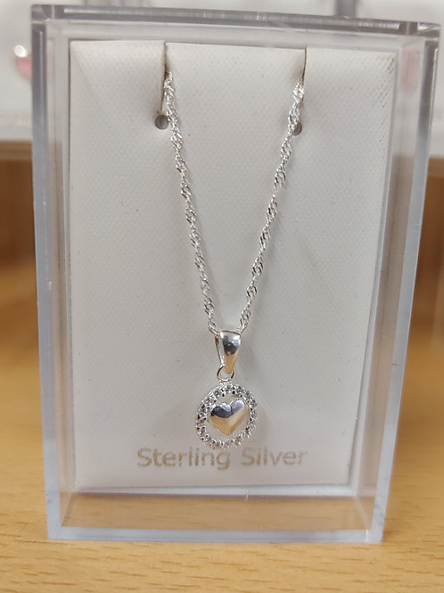 Pretty heart set in CZ circle. 925 silver pendant and chain.