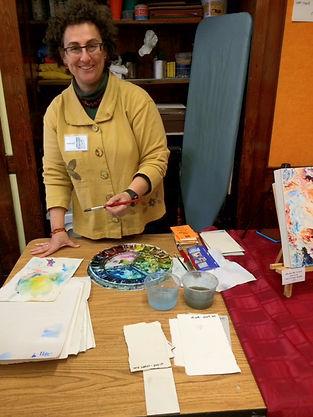 Photo of Lisa Goren doing a watercolor demo