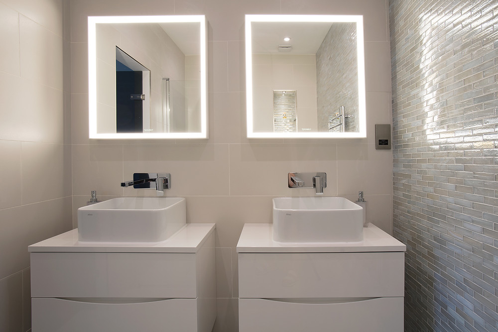 Glass mosaics tiles as accent wall and larger format tiles