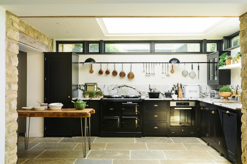 Beautiful Interior design Cotswold kitchen with natural stone and elements.