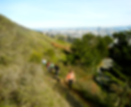 A hiking group climbs the unmarked trail to Twin Peaks