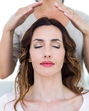 Woman getting reiki therapy on white bac