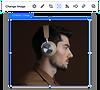 Photo of man wearing headphones below website breadcrumbs