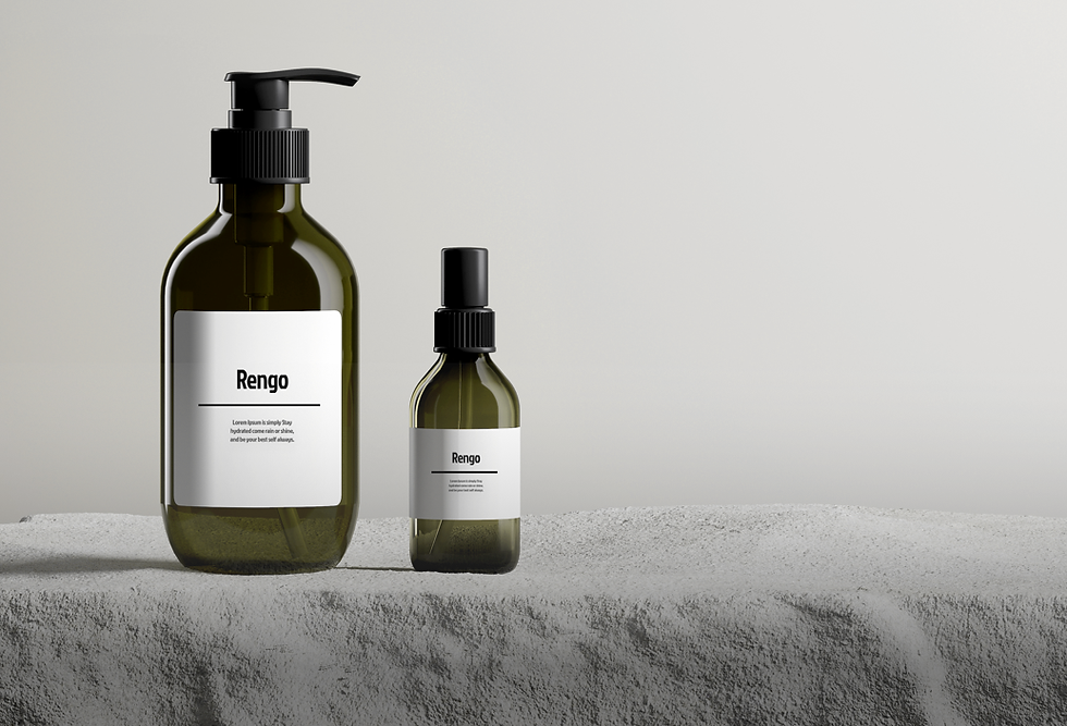 2 bottles of cosmetics on a gray background, sitting on a grey fuzzy level. There is text on the bottom left corner and an icon on the bottom right.