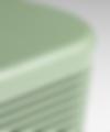 image of side of green speaker on grey background