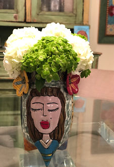 Vase with Women's Faces and Fresh Cut Flowers