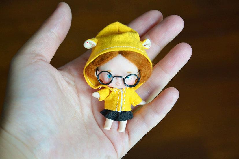 Yellow hood tiny doll