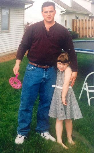 Rick Olson and his youngest child, Anna.