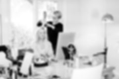 Wedding hair stylist Olga styling bridesmaid's hair