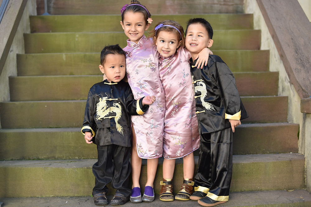 Photo of 4 kids dressed in Chinese outfits