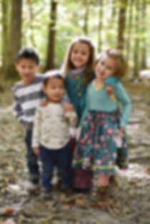 Shannon's 4 kids, playing in the forest in North Carolina.
