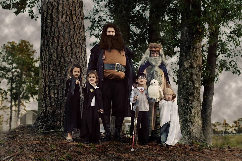 Our family dressed up as characters from Harry Potter against a tree background.