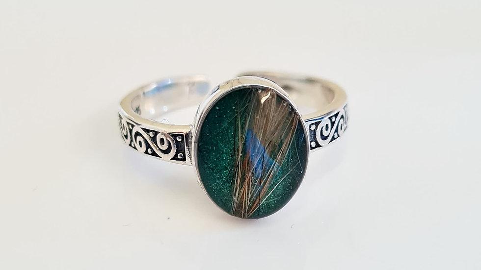 Adjustable ornate oval ring