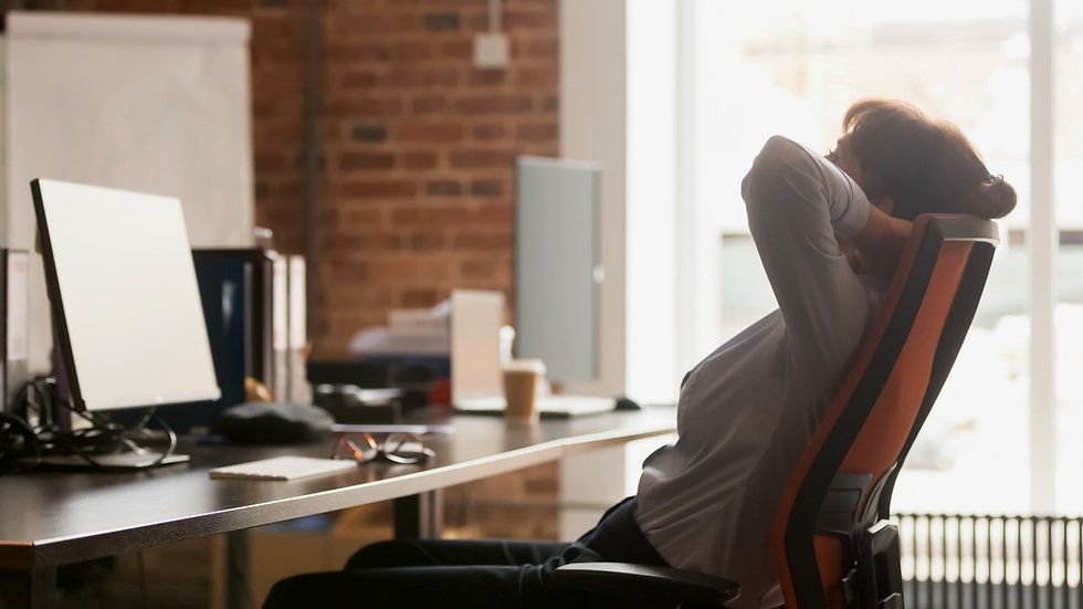 Calm businesswoman office worker holding hands behind head finished computer work at workp