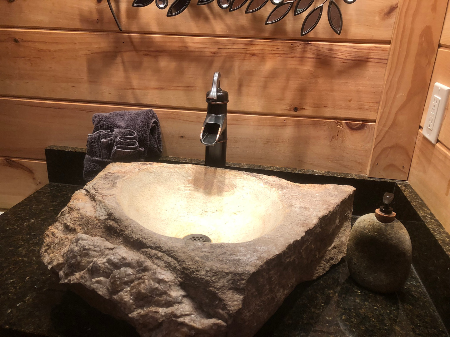 Handmade rock sink in the Fontana's full bath.