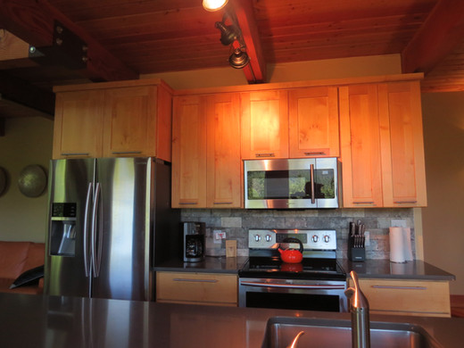 All kitchen appliances are available in the Stecoah House kitchen, including dishes and cookware.