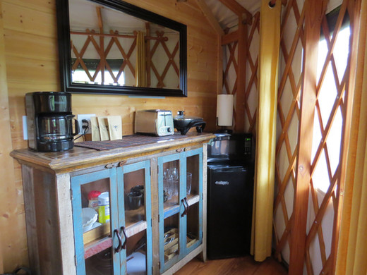 The Cherokee offers guests a small efficiency kitchen with a small fridge, microwave, toaster, electric skillet, coffee pot and dishes.  Plus coffee from local roasters, filters, cream and sugar.