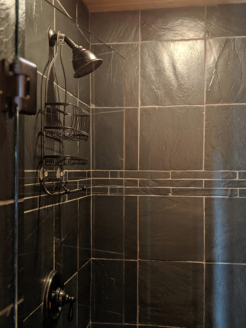 Slate walk-in showers are available in all of our yurts.