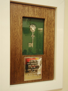 The silver key in its glass display case, made by Bob Heaton