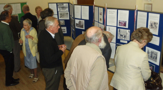 Visitors enjoying the exhibition of the history of the Parish Room and the village