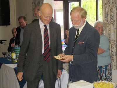 Sir Hugo Brunner (left) and Bob Heaton, ABCA Chairman, with the silver key with which Sir Hugo's great grandfather, Sir John Brunner, opened the Parish Room in 1909. Sir Hugo has generously donated the key to the Parish for safe keeping (photo by Rosemary Mullett)