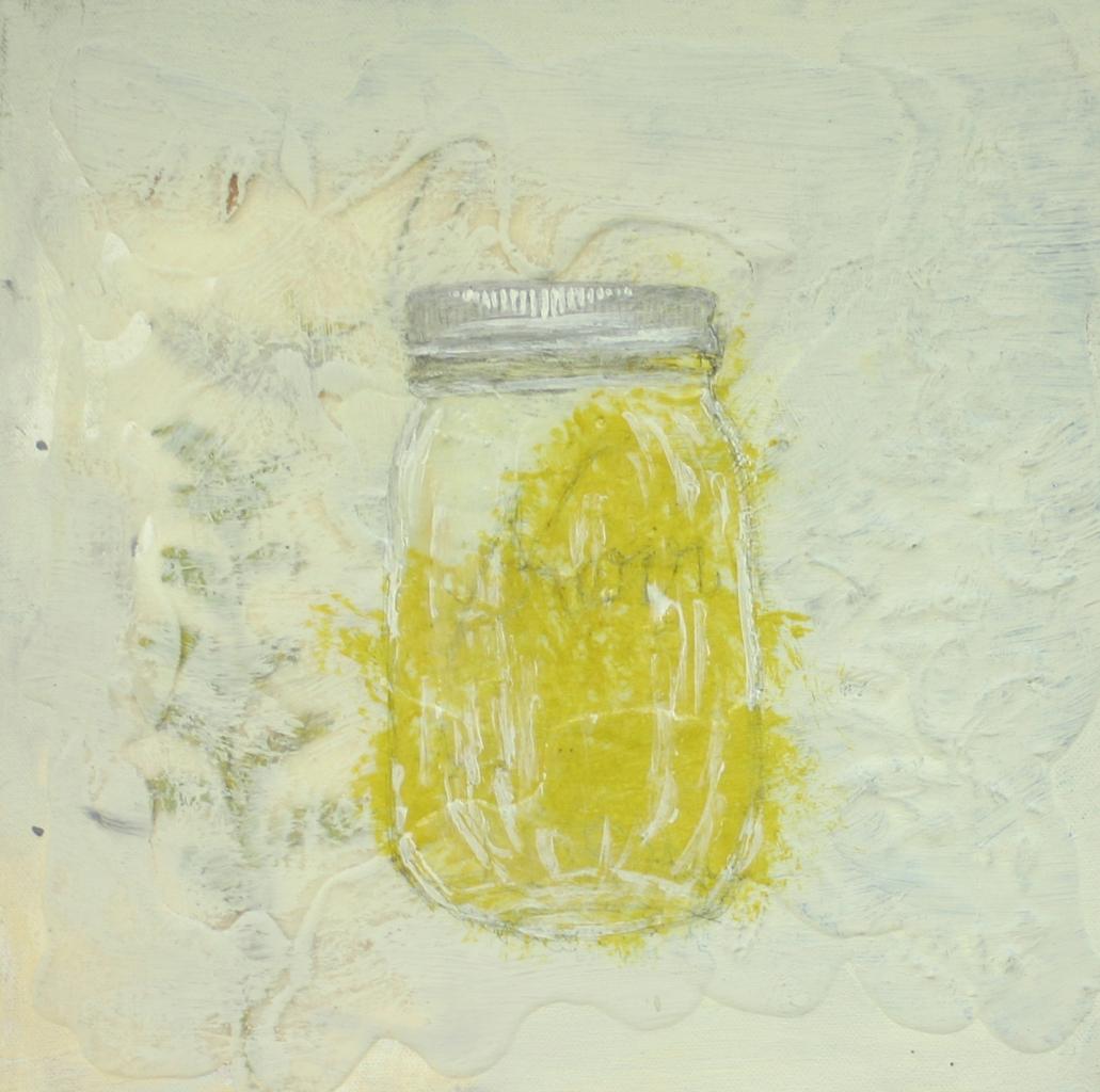 clear jar w.yellow on waxy cream
