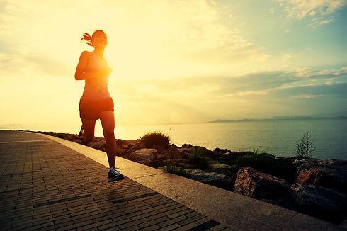 Runner athlete running at seaside. woman