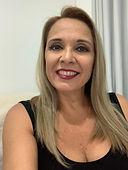 Foto de mulher sorrindo.