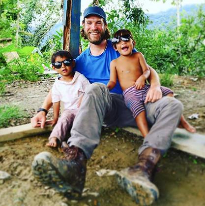 Jimi with kids_Peru.png