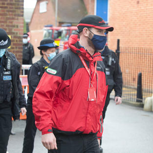 Kent Search and Rescue volunteer with Kent Police Officers during Operation Barton