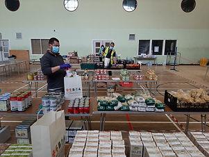 Volunteer with food provisions at Canterbury community hub