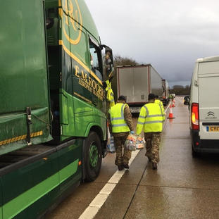 Army distribute food donations on the M2