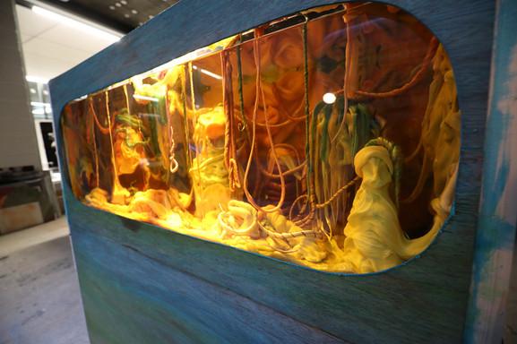 Sugar, glucose, food dye, vegetable oil, glass, metal frame & wood, 122 x 40 x 90cm