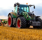 green-tractor-plowing-the-fields-on-focu