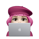 memoji of pink haired woman sitting at a computer