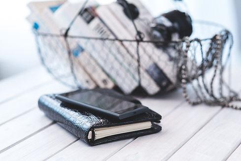 Canva - Elegant black notebook with mobi