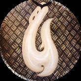 Maori whale bone pendant on woven flax