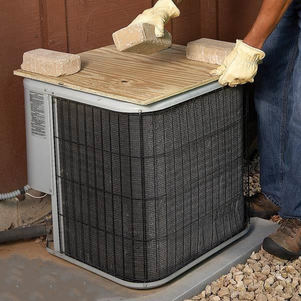 Plywood on top of air conditioner condenser