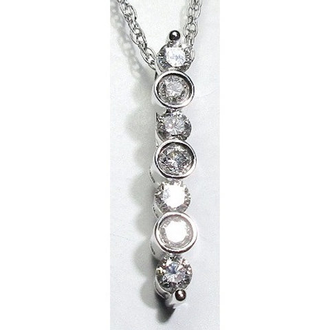 This 14k white gold 7-stone pendant features 1/2 carat total weight of bezel an