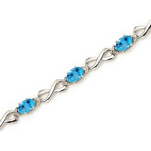 10K White Gold Oval Blue Topaz and Diamond Bracelet