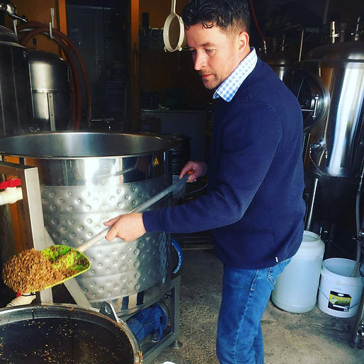Dave Henderson brewing Hop and Clover beer