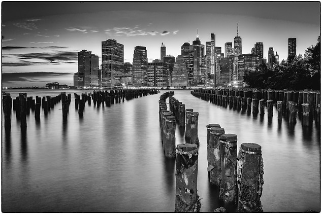 Old pier pylons and downtown Manhattan