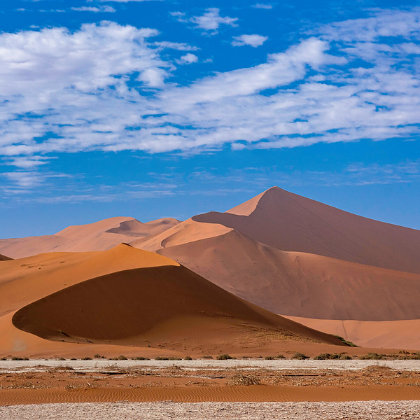 Red sand dunes and blue skies
