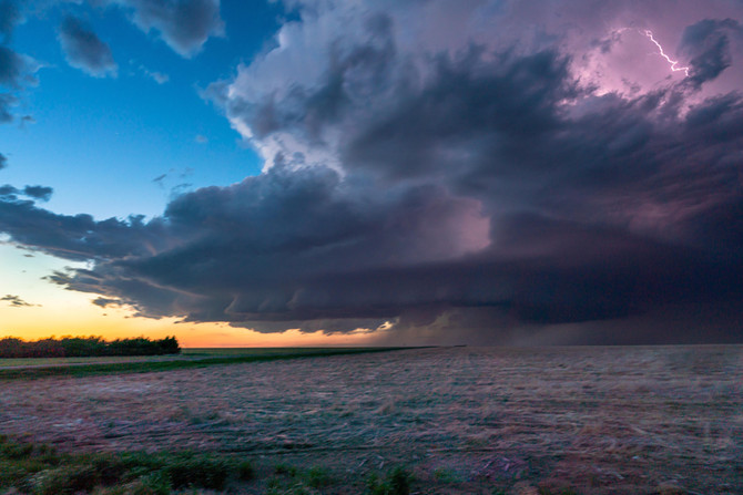 Storm lights up at sunset