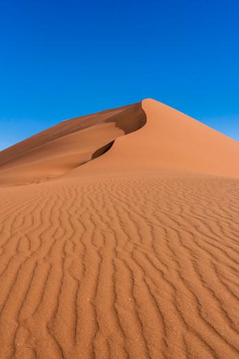 Orange sand and blue skies